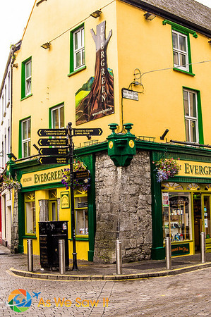 Yellow building with green trip and stonework probably dates from early days of Galway