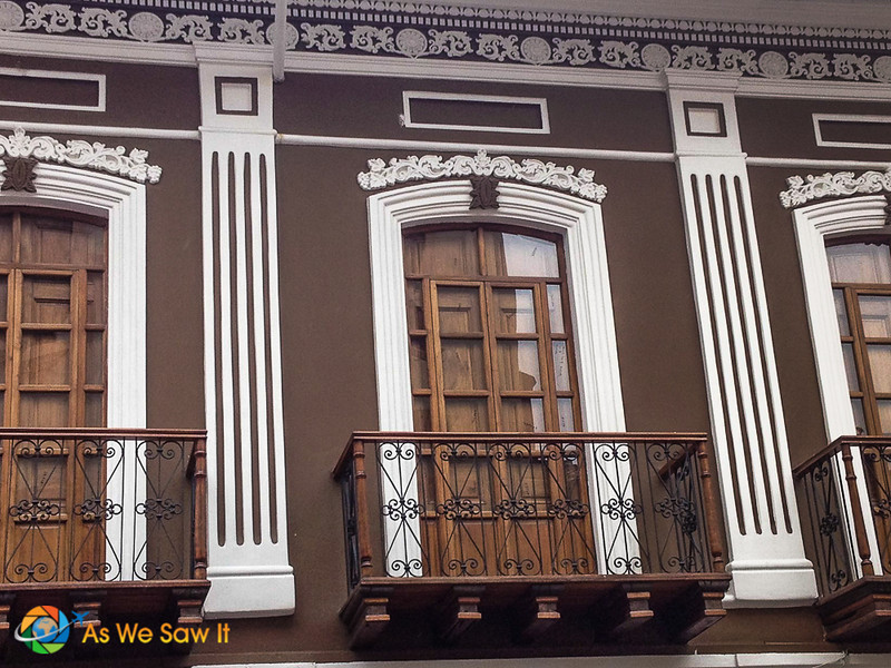 Details in the woodwork on this balcony in Cuenca pop against the brown.