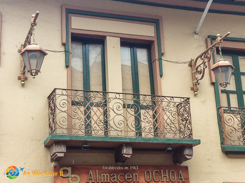 This balcony in Cuenca is highlighted by lamps.
