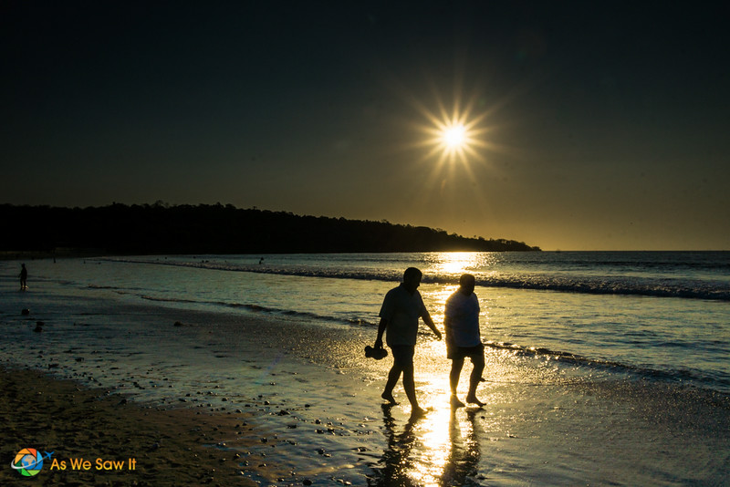 couple walking along beach in Jimbaran, Indonesia