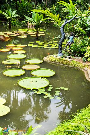 Child swing sculpture along lake Singapore Botanic Gardens