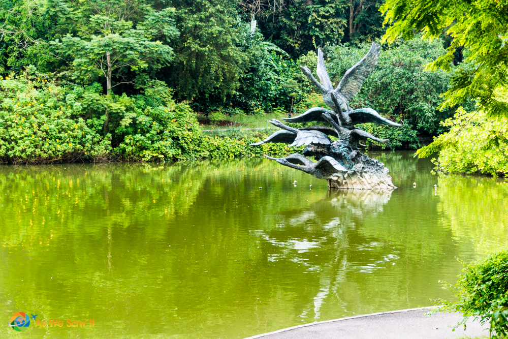 statue of geese in flight in a Singapore Botanic Gardens lake