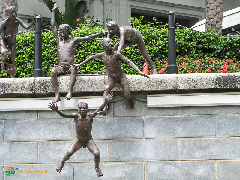 """""""First Generation,"""" a sculpture in front of the Fullerton Hotel"""