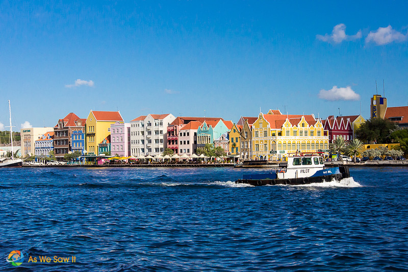 View of Willemstad's colorful buildings with boat on the water