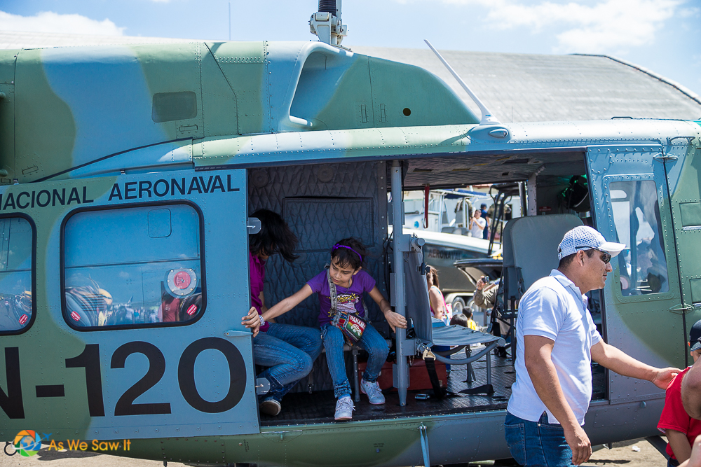 Children aboard a national guard helicopter.