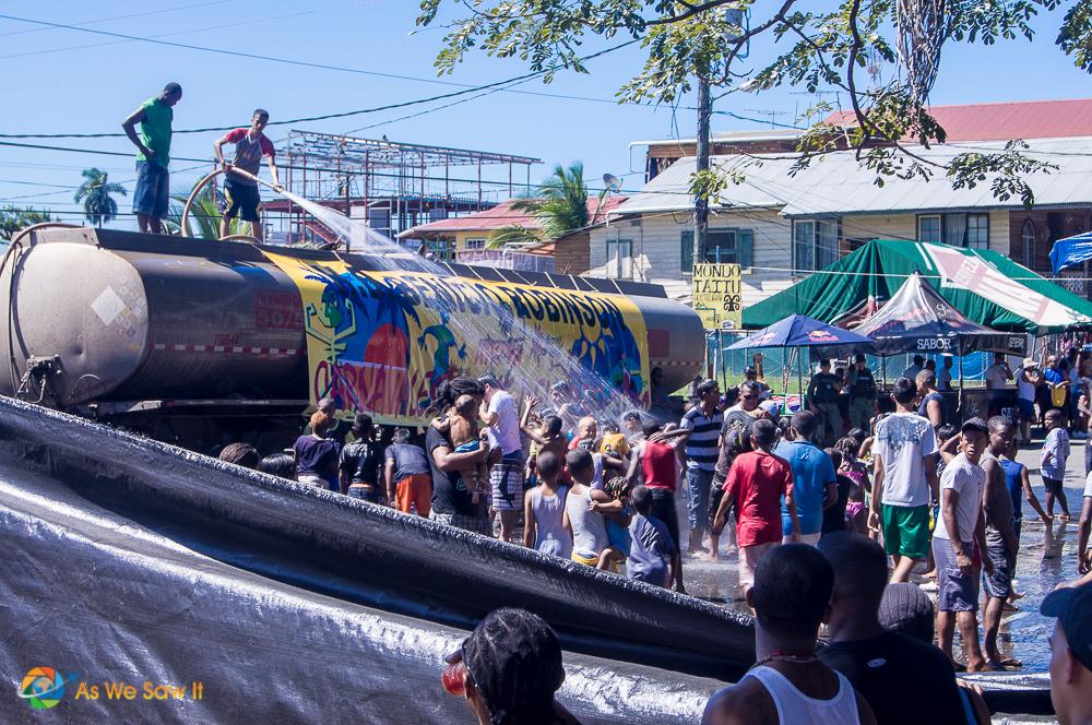 Mojaderas douse a crowd of Carnival revelers in Bocas del Toro, Panama
