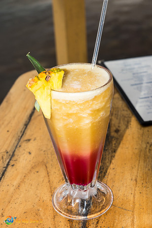 A tropical drink in Bocas del Toro, Panama: pineapple and orange juices blended with grenadine syrup.