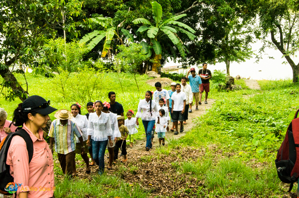Campesinos walk on a trail in Panama