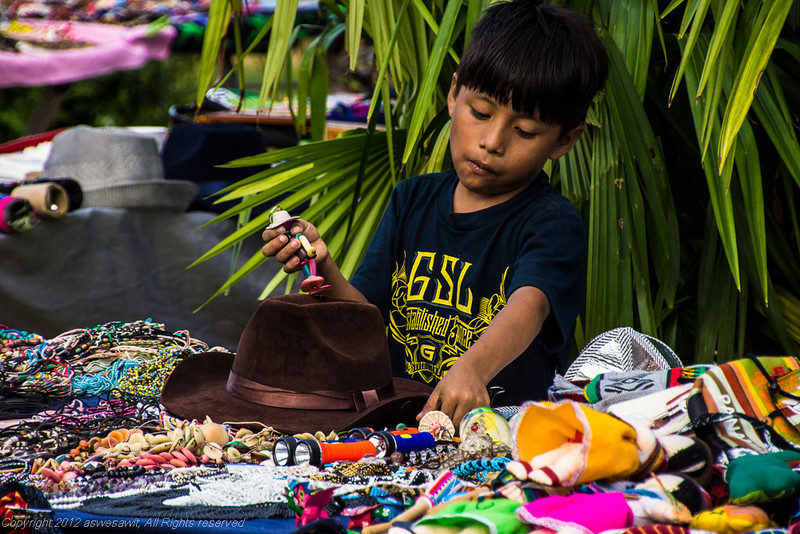 Boy selling items at Carnaval in Panama City