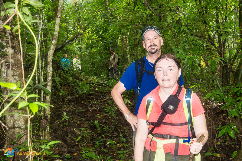 Two people, sweating from hiking in the Darien Gap.