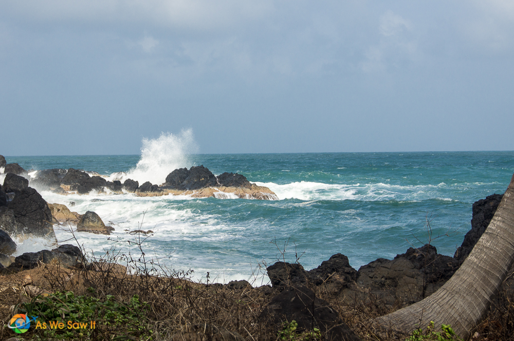 Waves crash on the east end of Isla Grande Panama, sending spray into the wind.