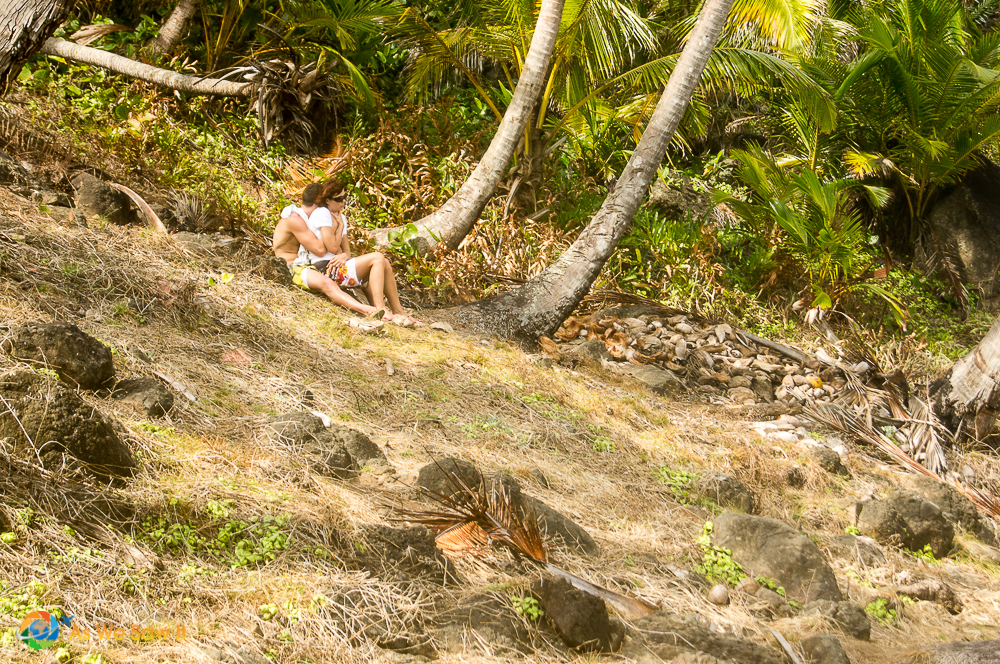 Couple enjoying the quiet coastline of Isla Grande.