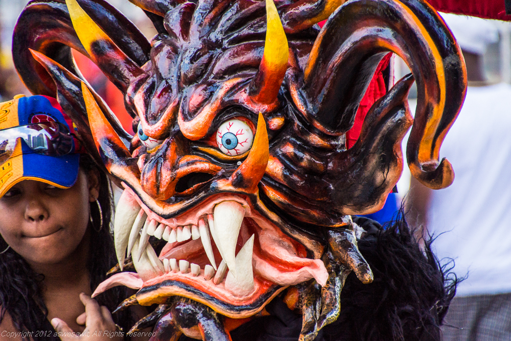 One of the diablos poses for a photo during Panama Carnival.