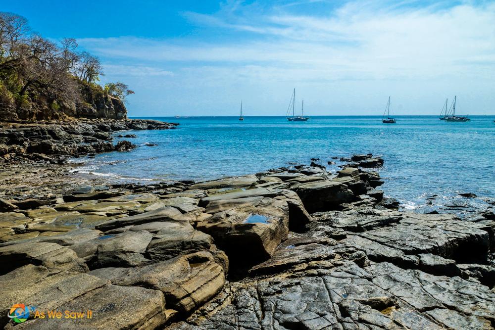 Rocks mingle with beach on Contadora