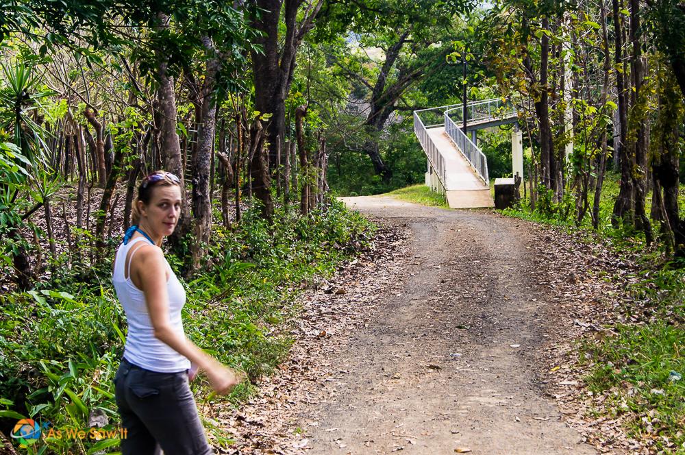 Our friend Linda walking ahead seeing a foot bridge.
