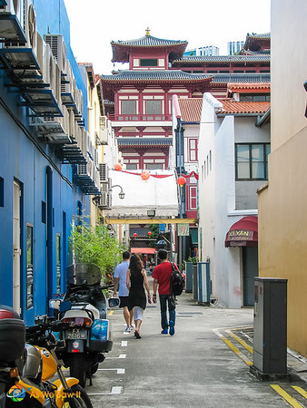 Chinatown side street with buddha tooth temple in the background