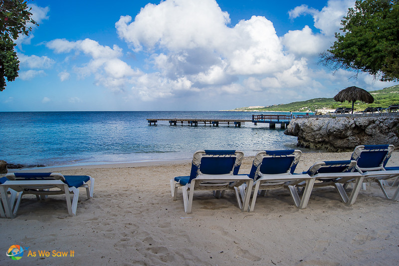 Private lounge chairs on a beach, overlooking the water at a couples resort in Curacao