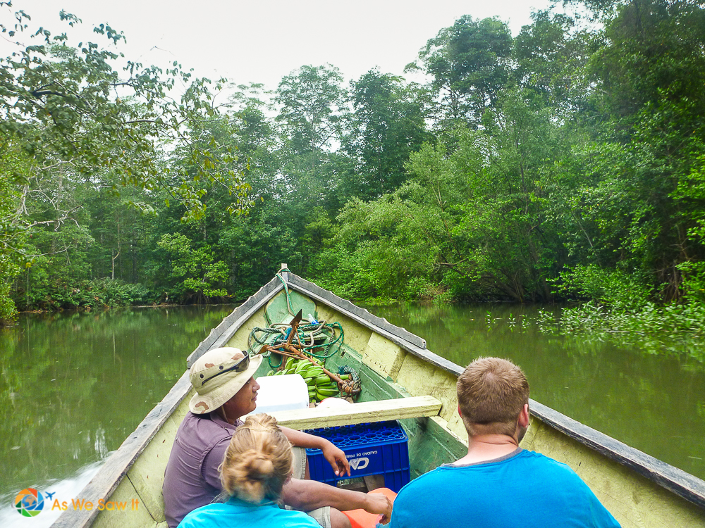 3 people in bow of a boat on a river in Darien, Panama