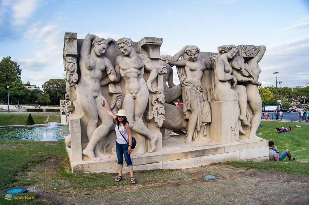 Posing with statues in Paris France