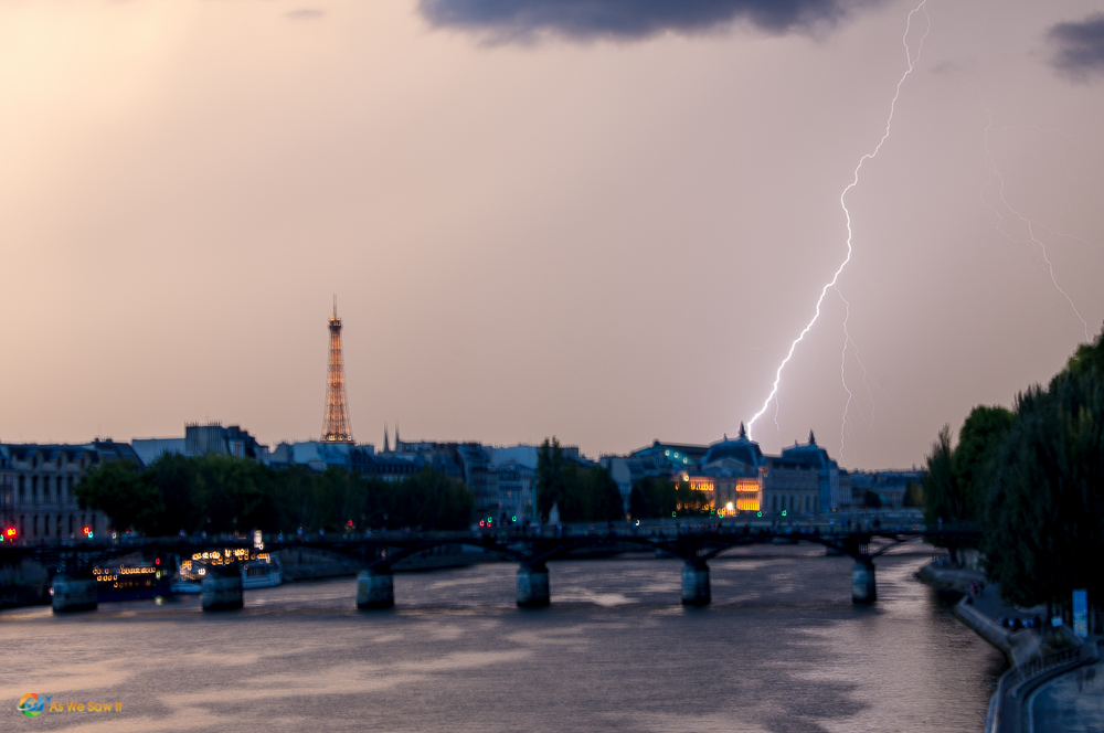 Lightning along the Seine River in Paris, France.