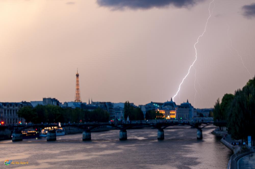 Lightning along the Seine River in Paris, France.