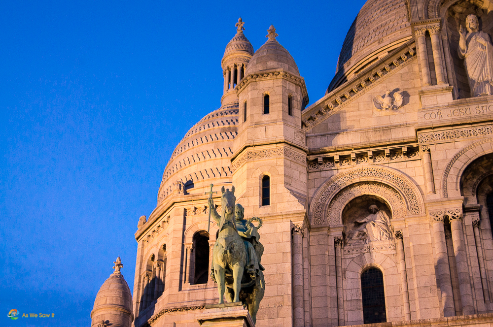 The setting sun reveals all the details of Sacre Coeur, Paris.