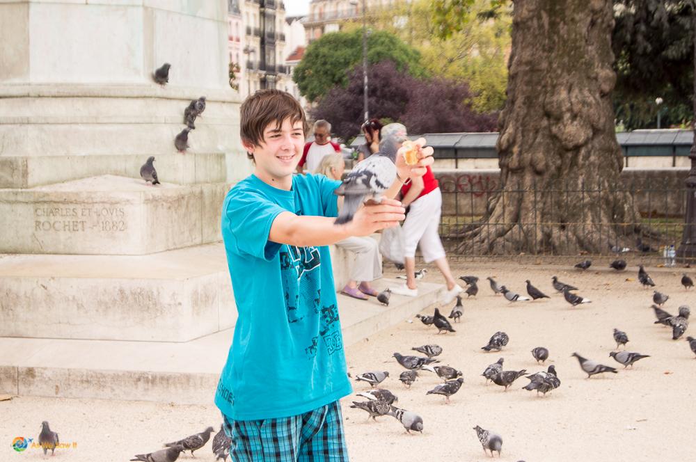 Feeding the pigeons in Paris, France.