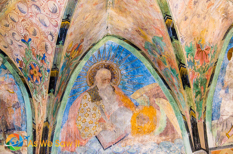 In this fresco, St. Mark holds a Bible and his Lion looks on.