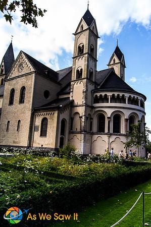 view of St. Kastor's church during Koblenz Flower Show, with flowering garden