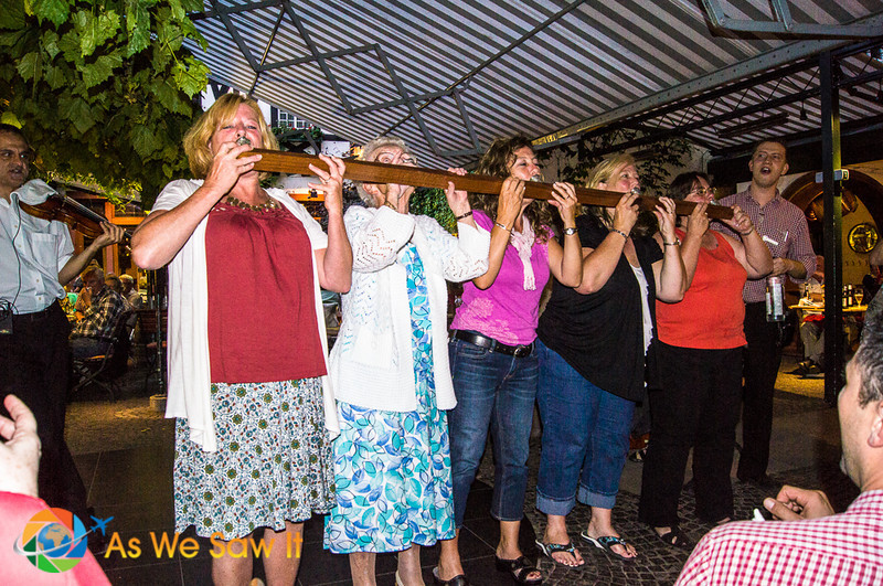 5 people demonstrate a schnapps board in Rudesheim, Germany during a river cruise dinner excursion