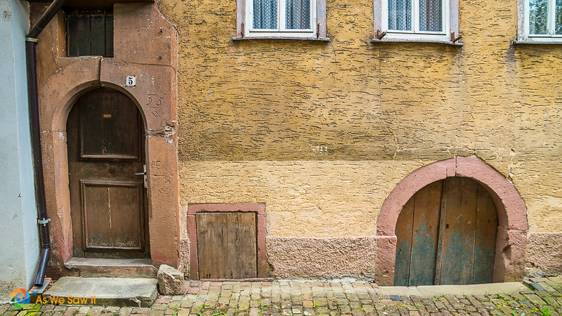 Doorways partially submerged below the pavement in Wertheim Germany