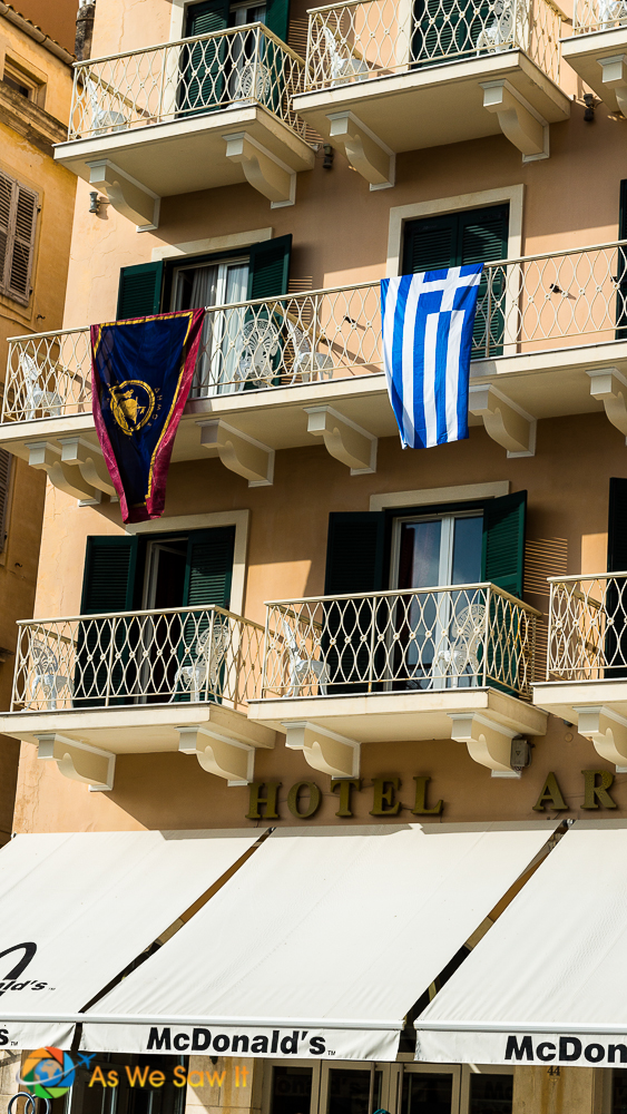 A balcony proudly displays the Greek flag on Ohi Day in Corfu