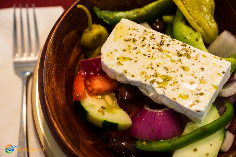 individual authentic greek salad with fork and napkin