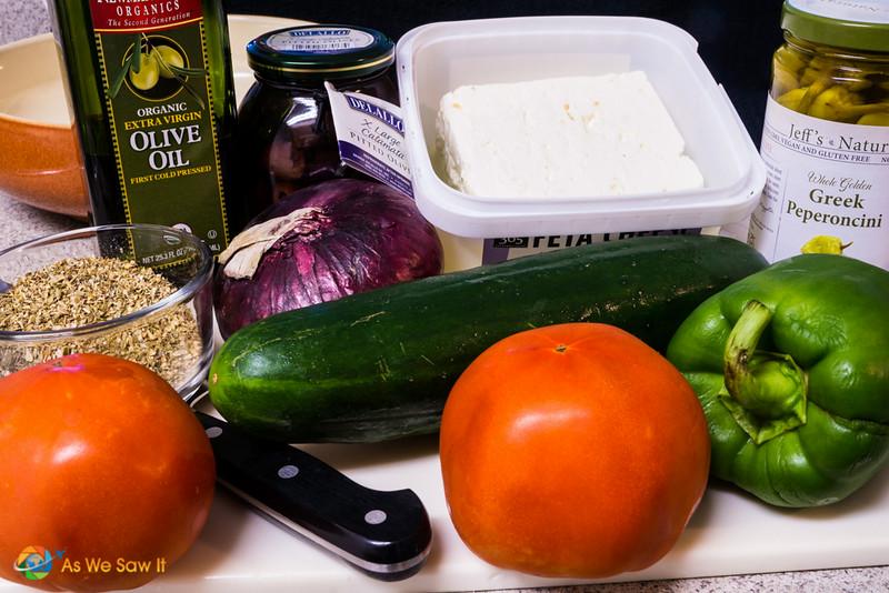 Greek salad ingredients on a cutting board
