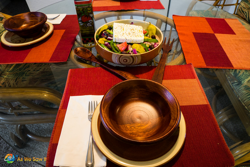 table with bowl of authentic Greek salad