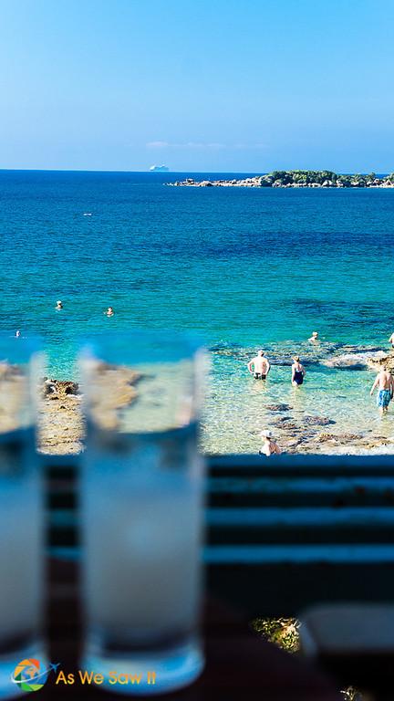 Enjoying ouzo at a beach in Greece