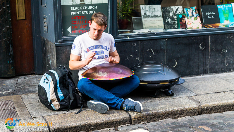 performer seated in Temple Bar street