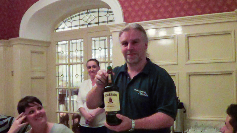 Mick presents a bottle of Jameson Irish whiskey, meant for the Irish coffee