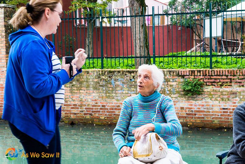 Linda talks to a woman making lace on Burano island