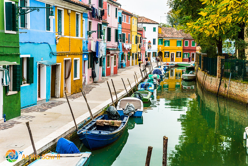 Colorful buildings along a canal on Burano island