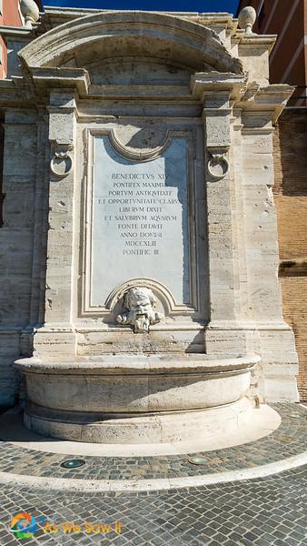 Civitavecchia travertine mask on fountain of Vanivitelli,