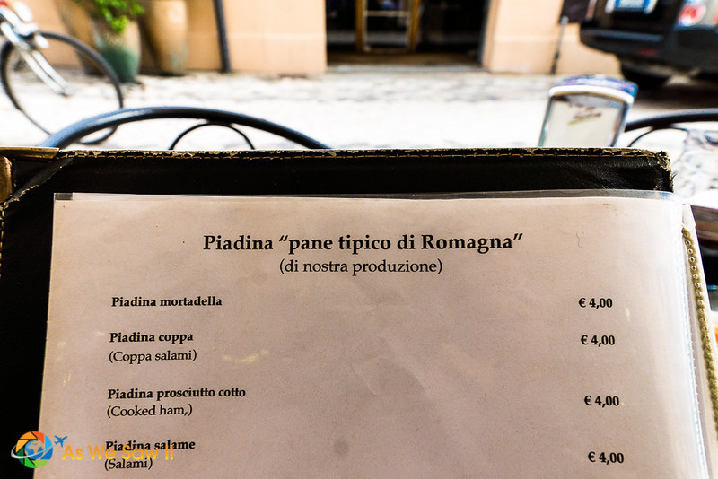 "Piadina menu from a shop in Ravenna. Price is 4 euros each. Title, translates to Piadina ""bread typical of Romagna"" (of our production)."