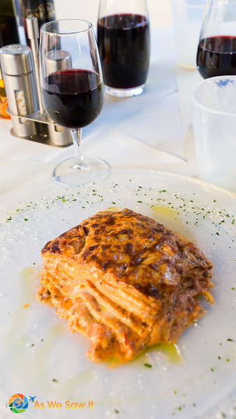 Baked lasagne and a carafe of local red wine, served al fresco in Venice, Italy