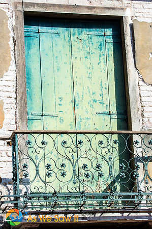 A weatherbeaten window balcony in Venice, Italy