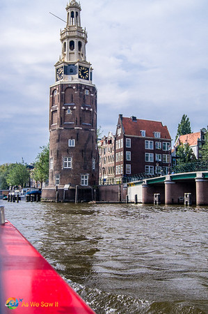view of a waterside tower from a Amsterdam cruise boat