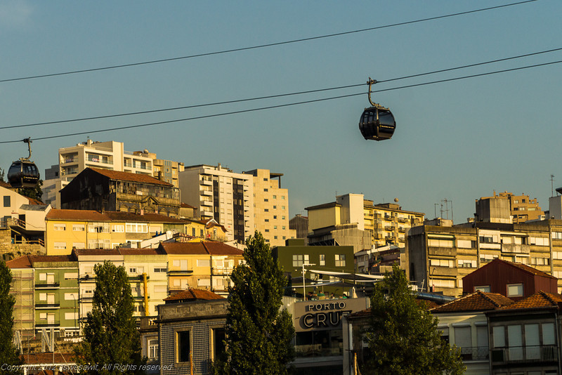 Gondolas and cables above buildings in Porto.