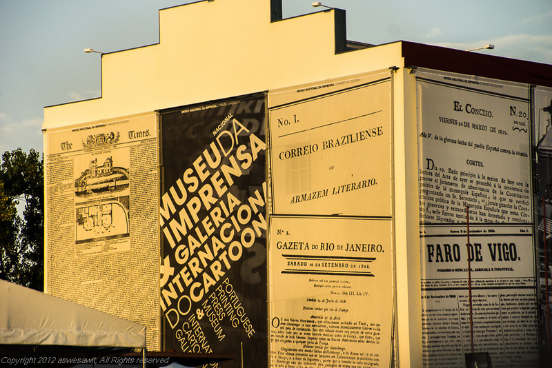 Exterior of the media museum in Porto. Decorated with huge murals that look like newspapers.