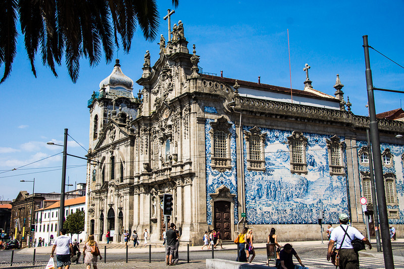 Porto's Baroque Igreja do Carmo is covered in azulejo tiles. The tower of Igreja dos Carmelitas can be seen in the background.