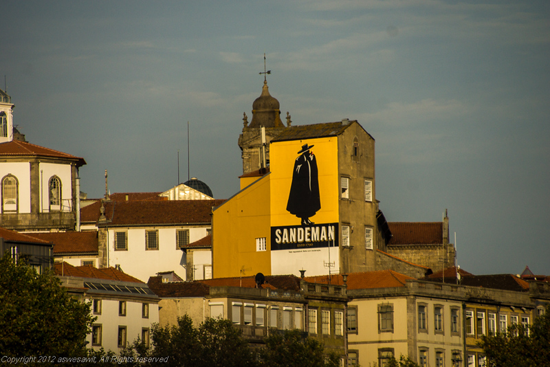 Mural on the side of the Sandeman Port House, across the Douro River from Porto