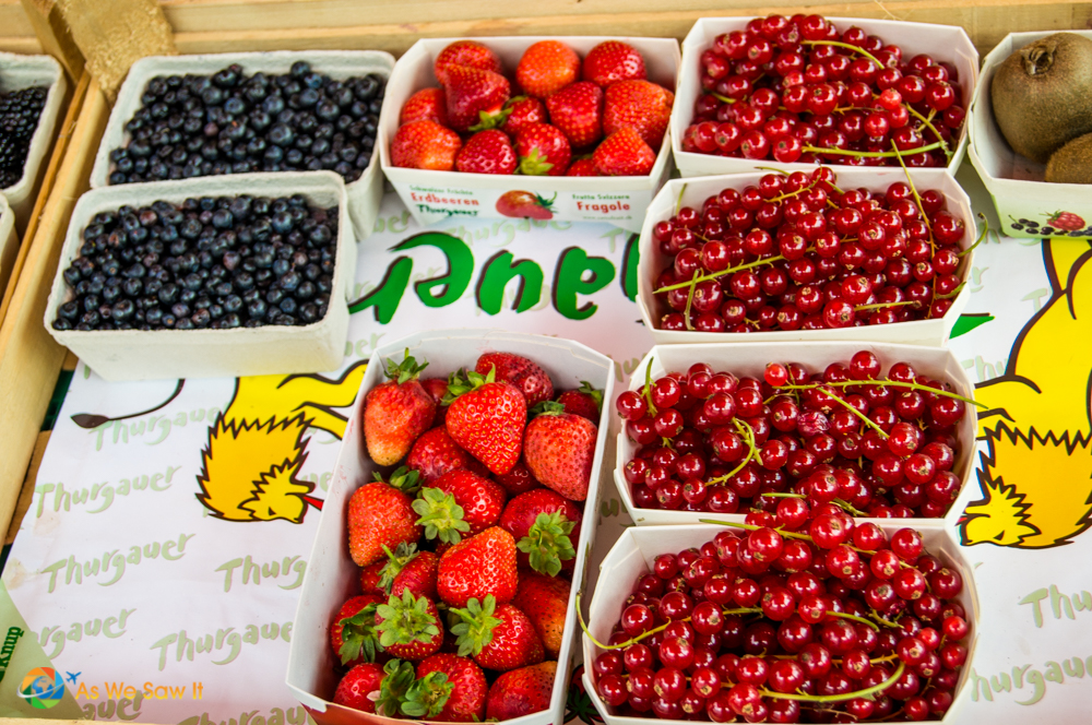 Fresh cherries, strawberries and blueberries in Marktplatz, Basel.
